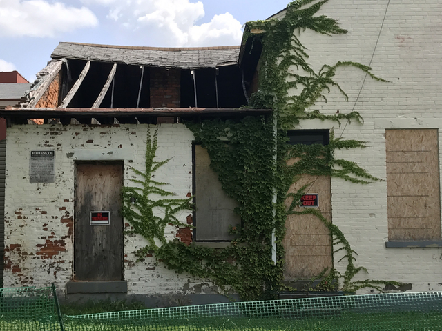The roof is caved in at the back of 320 Pershing Ave. in Covington, one of the two homes that owner Joe Stevie would still like to tear down and replace with condos.